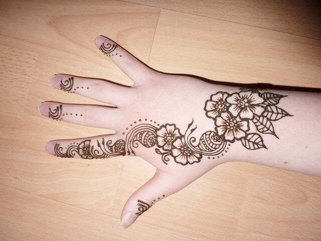 Henna design with floral and paisley pattern