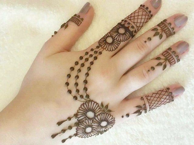 Henna designs in hand jewelry style