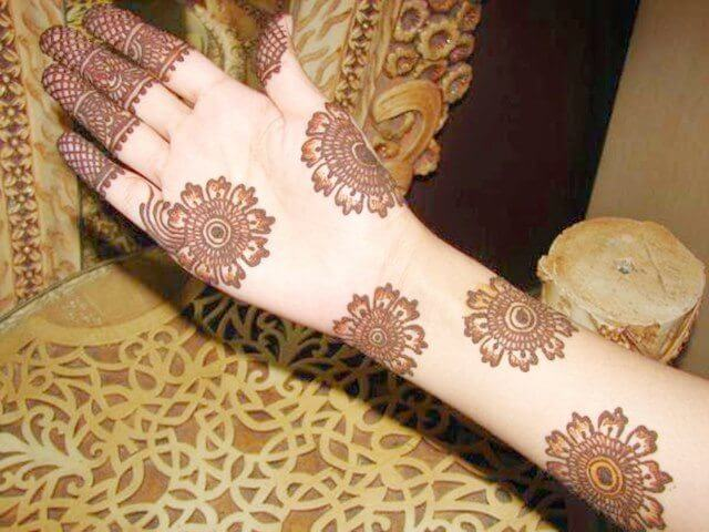 Henna designs with minimal floral designs